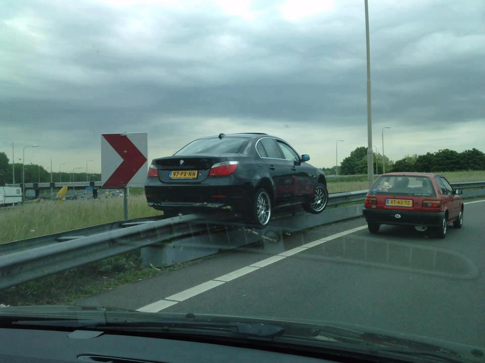 funny bmw over a highway rail