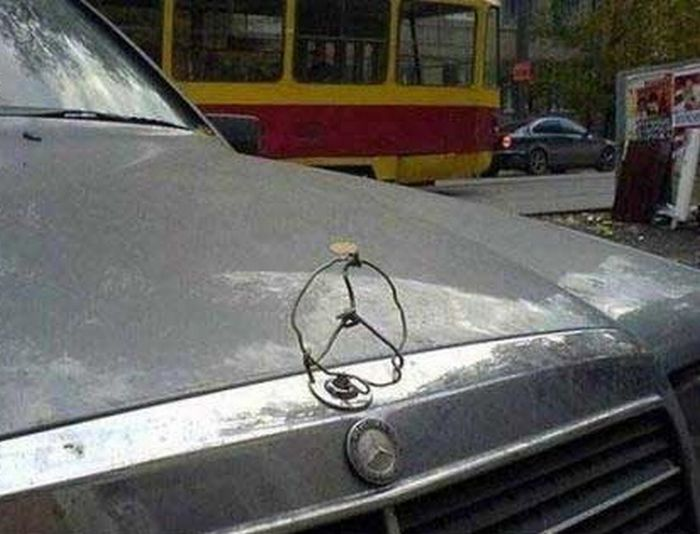 Funniest photo gallery with patchwork repairs on cars these guys hilarious improvised mercedes car emblem solutioingenieria Gallery